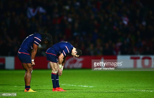 Zach Test and Thretton Palamo of the United States look dejected after defeat in the 2015 Rugby World Cup Pool B match between USA and Japan at...