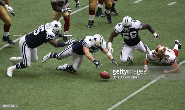 Zach Thomas of the Dallas Cowboys recovers a fumble against the San Francisco 49ers at Texas Stadium on November 23 2008 in Irving Texas