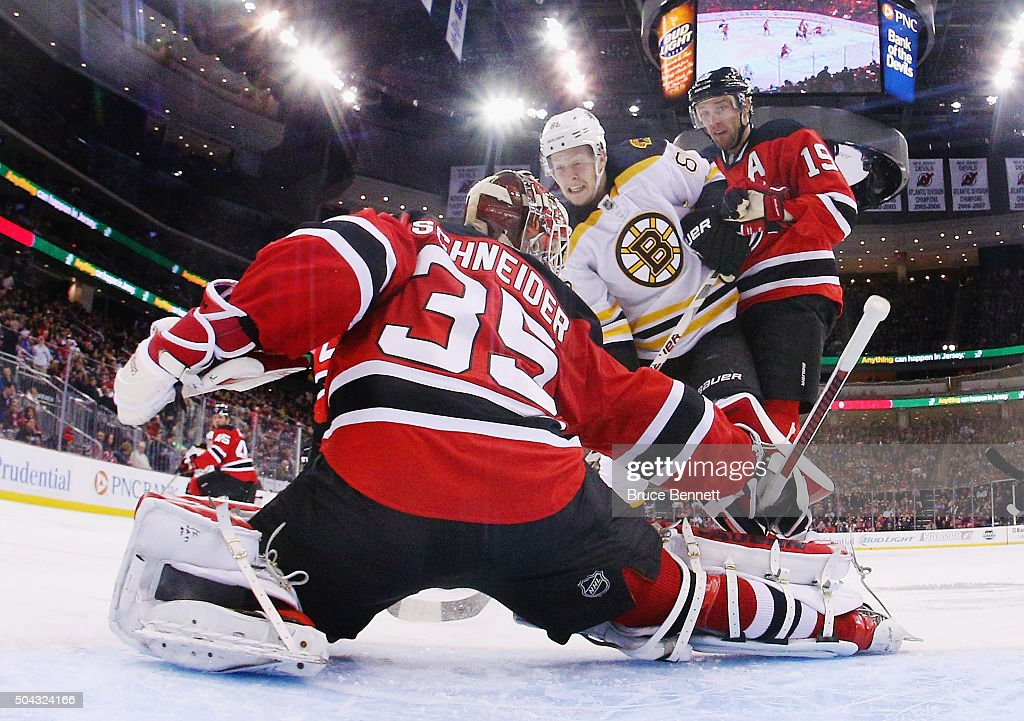 Zach Trotman #62 of the Boston Bruins skates in on Cory Schneider #35 of the New Jersey Devils at the Prudential Center on January 8, 2016 in Newark, New Jersey. The Bruins defeated the Devils 4-1.