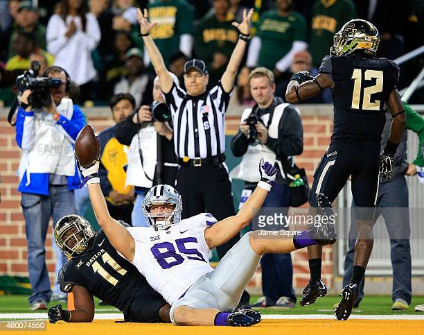 Zach Trujillo of the Kansas State Wildcats scores a touchdown as Taylor Young of the Baylor Bears and Alfred Pullom of the Baylor Bears defend during...