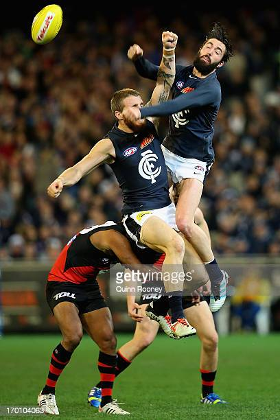 Zach Tuohy and Kade Simpson of the Blues collide as they spoil a mark during the round 11 AFL match between the Essendon Bombers and the Carlton...