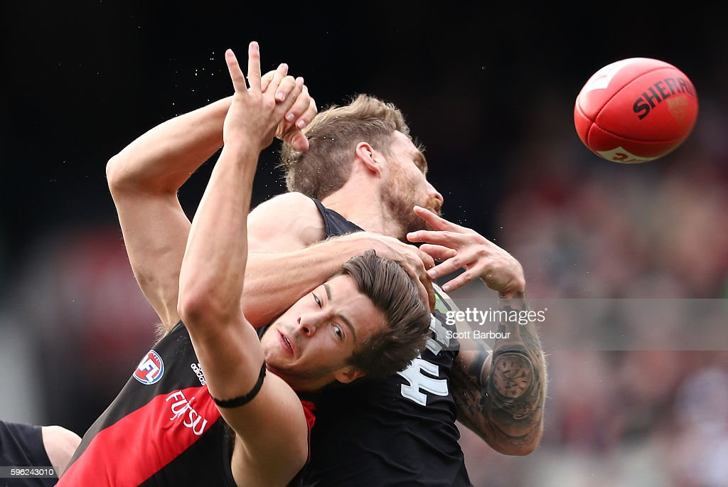 Zach Tuohy of the Blues and Kyle Langford of the Bombers compete for the ball during the round 23 AFL match between the Essendon Bombers and the Carlton Blues at Melbourne Cricket Ground on August 27, 2016 in Melbourne, Australia.