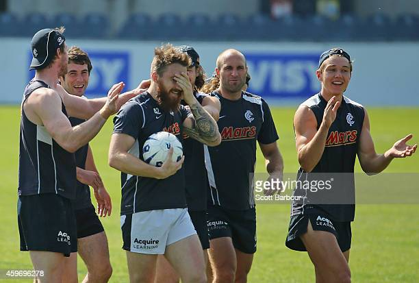 Zach Tuohy of the Blues is congratulated by his teammates after a training drill during a Carlton Blues AFL preseason training session at Visy Park...