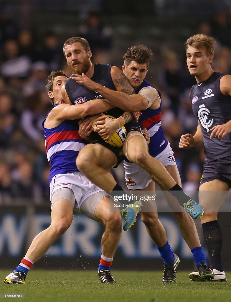 Zach Tuohy of the Blues is tackled during the round 20 AFL match between the Carlton Blues and the Western Bulldogs at Etihad Stadium on August 10, 2013 in Melbourne, Australia.