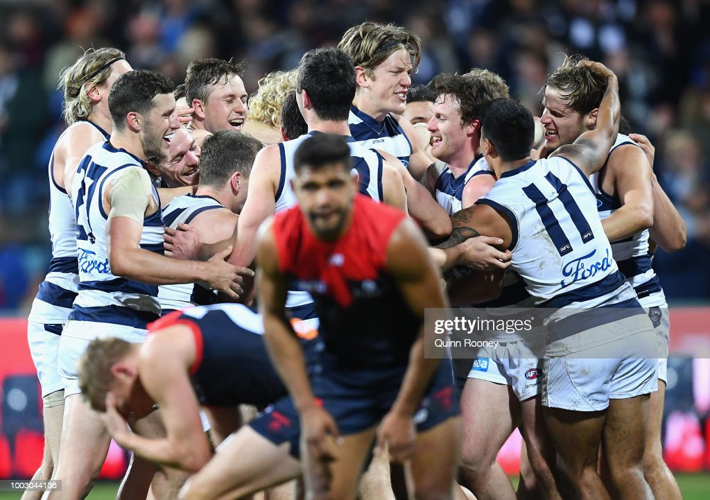 Zach Tuohy of the Cats is congratulated by team mates after kicking a goal after the siren to win the round 18 AFL match between the Geelong Cats and the Melbourne Demons at GMHBA Stadium on July 21, 2018 in Geelong, Australia.