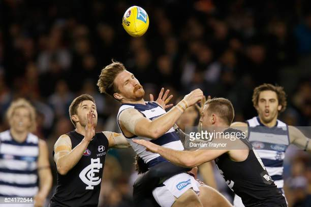 Zach Tuohy of the Cats is tackled during the round 19 AFL match between the Carlton Blues and the Geelong Cats at Etihad Stadium on July 29, 2017 in...