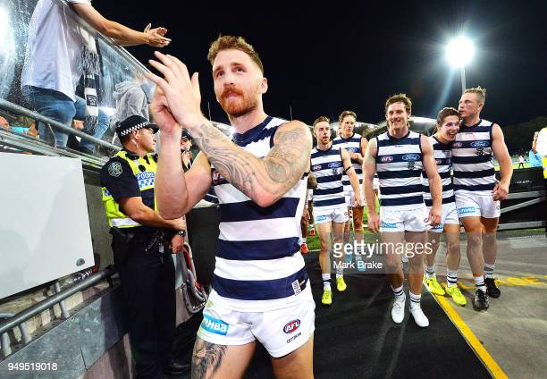 Zach Tuohy of the Cats leads the team down the race after winning round five AFL match between the Port Adelaide Power and the Geelong Cats at...