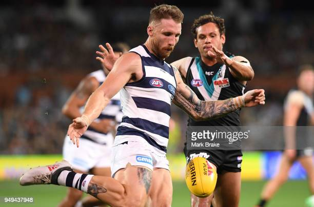 Zach Tuohy of the Cats under pressure from Steven Motlop of Port Adelaide during the round five AFL match between the Port Adelaide Power and the...