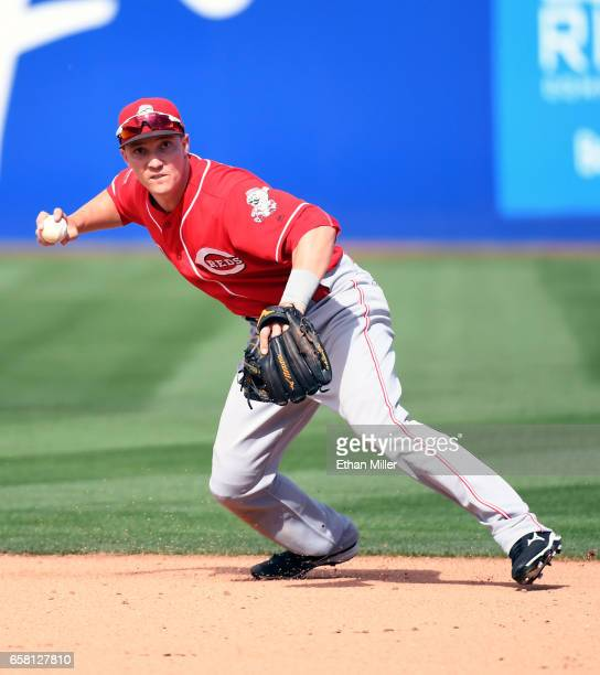 Zach Vincej of the Cincinnati Reds tries to throw out a Chicago Cubs runner at first base in the sixth inning of their exhibition game at Cashman...
