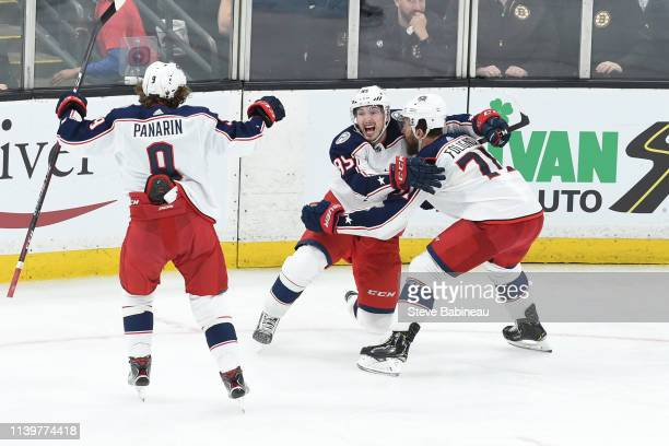 Zach Werenski Nick Foligno and Matt Duchene of the Columbus Blue Jackets celebrate the double overtime goal against the Boston Bruins in Game Two of...