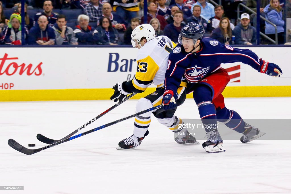 Zach Werenski #8 of the Columbus Blue Jackets attempts to steal the puck from Conor Sheary #43 of the Pittsburgh Penguins during the third period on April 5, 2018 at Nationwide Arena in Columbus, Ohio. Pittsburgh defeated Columbus 5-4 in overtime.