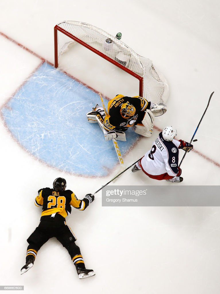 Zach Werenski #8 of the Columbus Blue Jackets can't get a shot off between Ian Cole #28 and Marc-Andre Fleury #29 of the Pittsburgh Penguins in Game Two of the Eastern Conference First Round during the 2017 NHL Stanley Cup Playoffs at PPG Paints Arena on April 14, 2017 in Pittsburgh, Pennsylvania. Pittsburgh won the game 4-1 to take a 2-0 series lead.