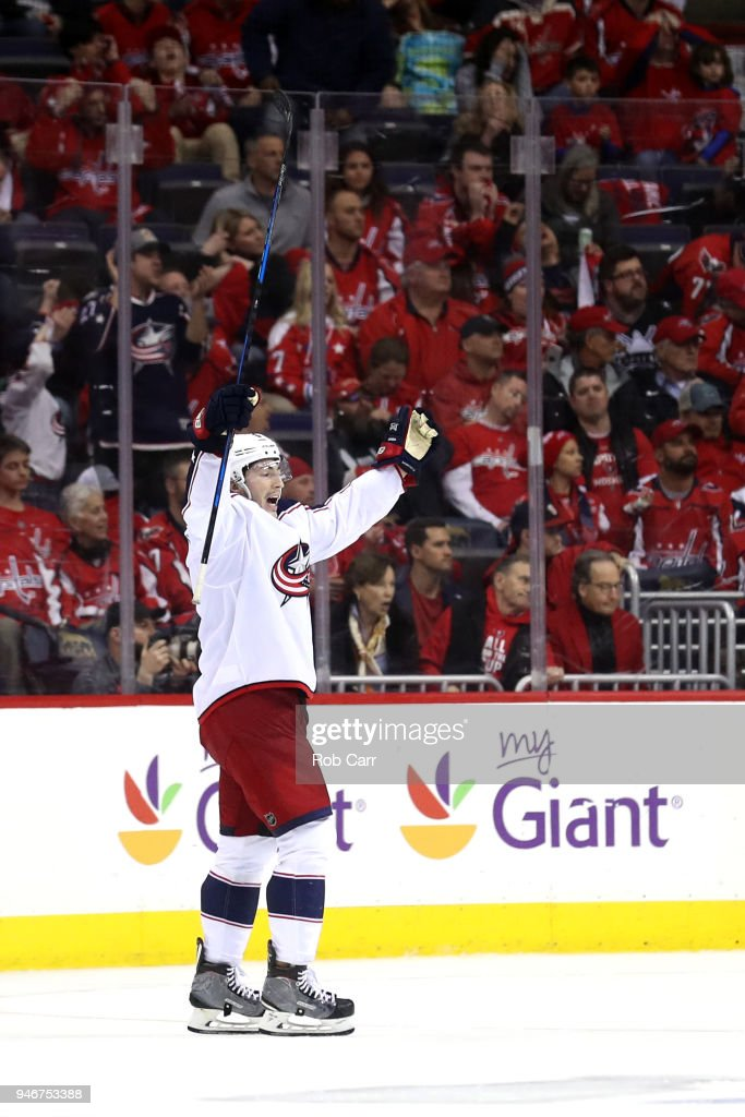 Zach Werenski #8 of the Columbus Blue Jackets celebrates after the Blue Jackets won 5-4 in overtime against the Washington Capitals during Game Two of the Eastern Conference First Round during the 2018 NHL Stanley Cup Playoffs at Capital One Arena on April 15, 2018 in Washington, DC.