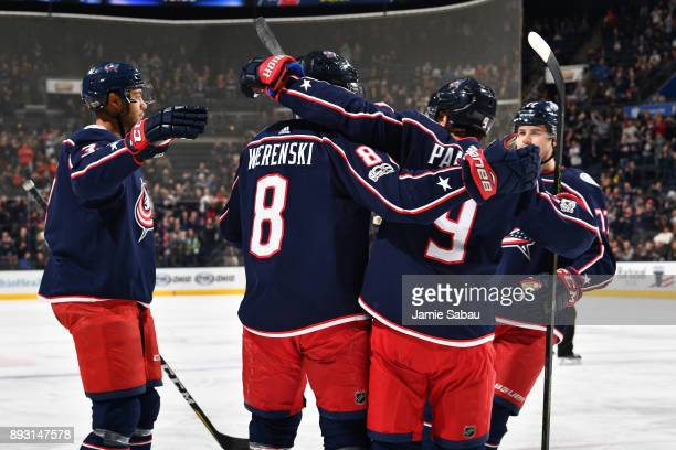 Zach Werenski of the Columbus Blue Jackets celebrates his first period goal with teammates Seth Jones Artemi Panarin and Josh Anderson of the...
