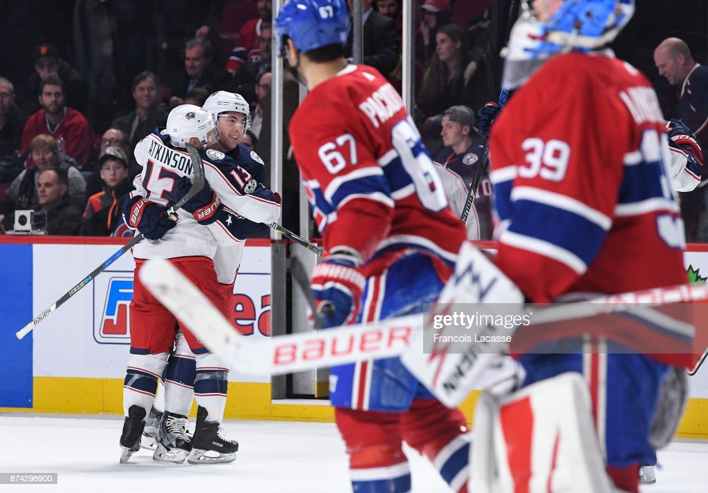 Zach Werenski #8 of the Columbus Blue Jackets celebrates his overtime goal against the Montreal Canadiens in the NHL game at the Bell Centre on November 14, 2017 in Montreal, Quebec, Canada.