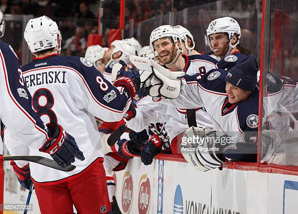 Zach Werenski of the Columbus Blue Jackets celebrates his second period goal against the Ottawa Senators with teammates Boone Jenner Brandon Saad and...