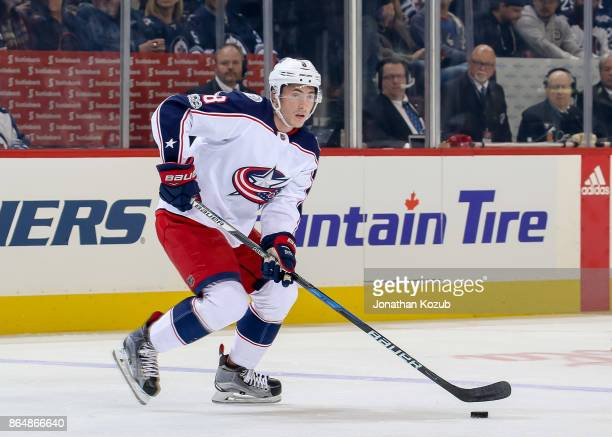 Zach Werenski of the Columbus Blue Jackets plays the puck up the ice during first period action against the Winnipeg Jets at the Bell MTS Place on...