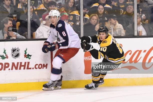Zach Werenski of the Columbus Blue Jackets skates against Anders Bjork of the Boston Bruins at the TD Garden on December 18 2017 in Boston...
