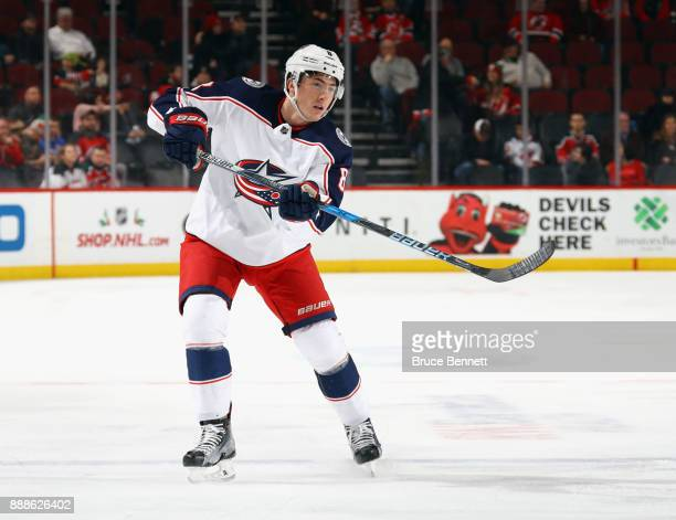 Zach Werenski of the Columbus Blue Jackets skates against the New Jersey Devils at the Prudential Center on December 8 2017 in Newark New Jersey The...