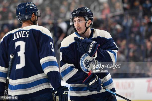 Zach Werenski of the Columbus Blue Jackets talks with Seth Jones of the Columbus Blue Jackets before a face off against the Winnipeg Jets on March 3,...