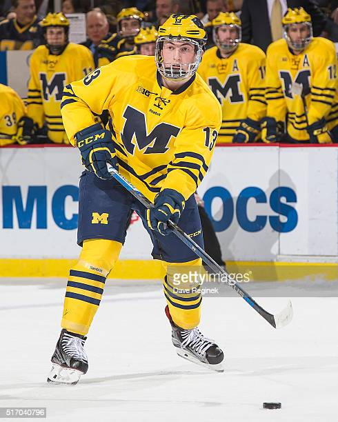 Zach Werenski of the Michigan Wolverines passes the puck against the Michigan State Spartans during the 'Dual in the D' inaugural game for the new...