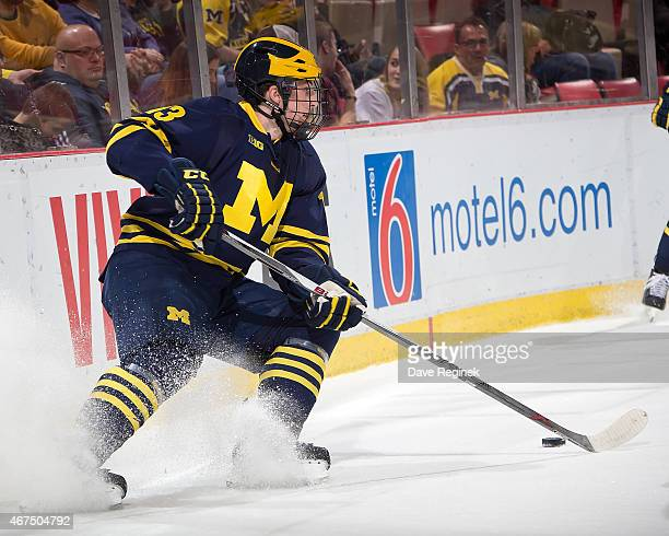 Zach Werenski of the Michigan Wolverines stops behind the net with the puck against the Minnesota Golden Gophers during the finals of Big Ten Mens...