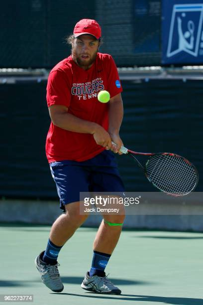 Zach Whaanga of the Columbus State plays a back hand against Barry University during the Division II Men's Tennis Championship held at the Surprise...