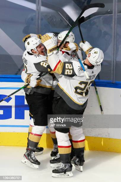 Zach Whitecloud of the Vegas Golden Knights is congratulated by his teammates Nick Holden and Nicolas Roy after scoring a goal against the St. Louis...