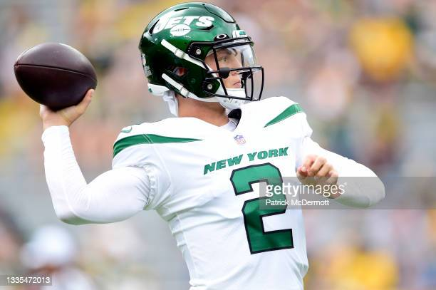 Zach Wilson of the New York Jets throws a pass during warmups before a preseason game against the Green Bay Packers at Lambeau Field on August 21,...