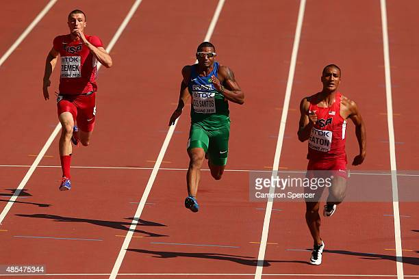 Zach Ziemek of the United States Felipe Dos Santos of Brazil and Ashton Eaton of the United States compete in the Men's Decathlon 100 metres during...