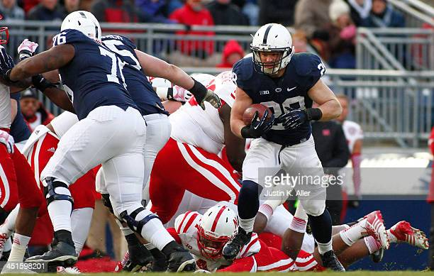 Zach Zwinak of the Penn State Nittany Lions rushes against the Nebraska Cornhuskers during the game on November 23 2013 at Beaver Stadium in State...