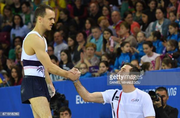 Zachari Hrimeche of France is congratulated by a staff member after he performed apparatus final for the European Artistic Gymnastics Championship in...
