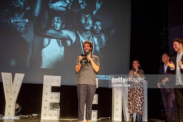 Zacharie Rabehi Photographer of the Year 2016 speaks on stage after he won the prize during the award ceremony of the EyeEm photofestival at...