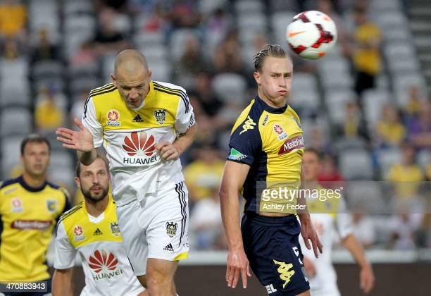 Zachary Anderson of the Mariners contests the header against Stein Huysegems of the Phoenix during the round 20 ALeague match between the Central...
