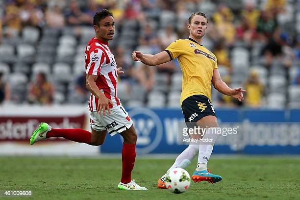 Zachary Anderson of the Mariners kicks the ball ahead of James Brown of Melbourne City during the round 15 ALeague match between the Central Coast...