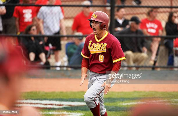 Zachary Bartholomew of Rocky Mountain High School celebrate his scoring in the 3rd inning of the game against Regis Jesuit High School at All City...