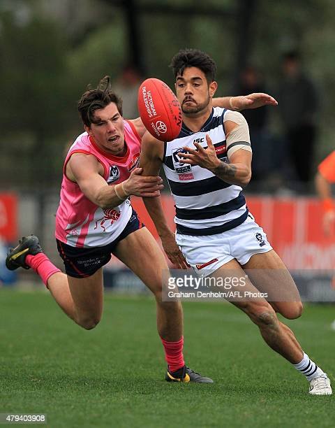 Zachary Bates of the Cats catches the ball under pressure from the Scorpions defence during the round 12 VFL match between the Casey Scorpions and...