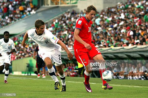 Zachary Carroll of USA struggles for the ball with Lucas Julis of Czech Republic during a match as part of the U17 World Cup at the Torreon Stadium...