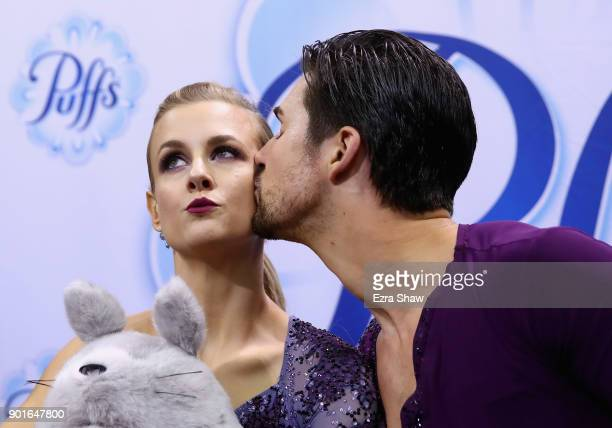 Zachary Donohue kisses Madison Hubbell in the kiss in the cry after getting their scores following the Championship Dance Short Program during Day 3...
