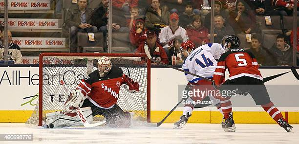TORONTO ON DECEMBER 19 Zachary Fucale gets to on a shot by Yegor Morozov as Team Canada plays Team Russia in a 2015 IIHF World Junior Championship...
