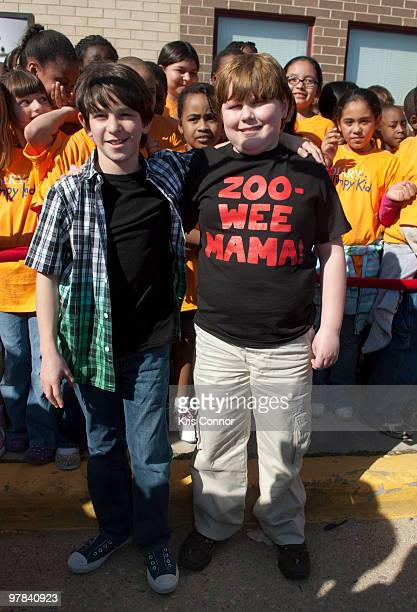 Zachary Gordon and Robert Capron pose for photographers during the premiere of Diary Of A Wimpy Kid at on March 18 2010 in Alexandria Virginia