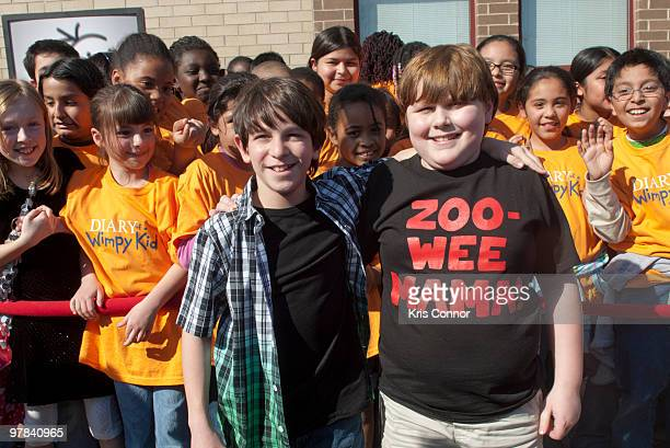 """Zachary Gordon and Robert Capron pose for photographers during the premiere of """"Diary Of A Wimpy Kid"""" at on March 18, 2010 in Alexandria, Virginia."""