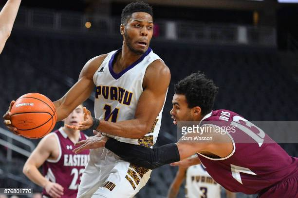 Zachary Hamilton of the Prairie View AM Panthers is defended by Jackson Davis of the Eastern Kentucky Colonels during day one of the Main Event...