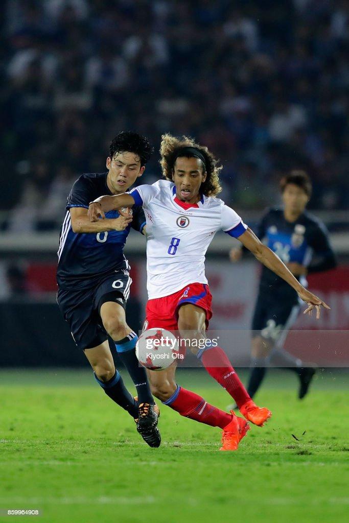Zachary Herivaux of Haiti and Wataru Endo of Japan compete for the ball during the international friendly match between Japan and Haiti at Nissan Stadium on October 10, 2017 in Yokohama, Kanagawa, Japan.
