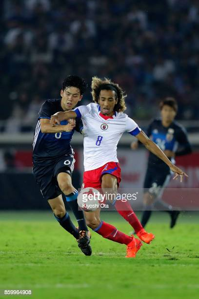 Zachary Herivaux of Haiti and Wataru Endo of Japan compete for the ball during the international friendly match between Japan and Haiti at Nissan...