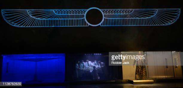 Zachary James as Scribe with artists of the company in English National Opera's production of Philip Glass's Akhnaten directed by Phelim McDermott at...