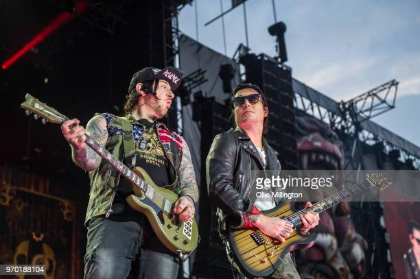Zachary James Baker aka Zacky Vengeance and Brian Elwin Haner Jr aka Synyster Gates of Avenged Sevenfold perform onstage during the bands main stage...