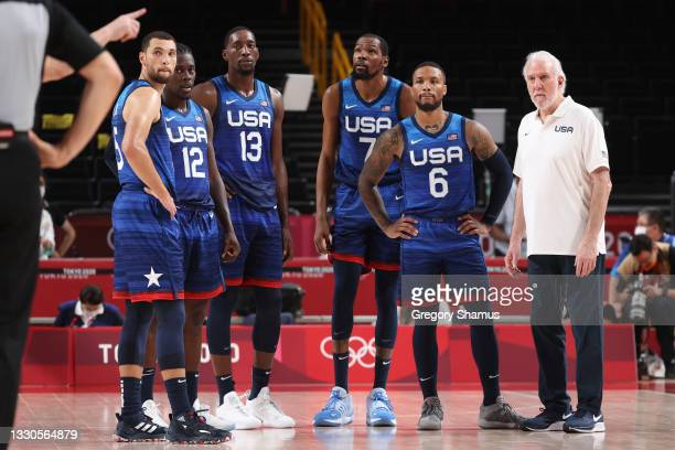 Zachary Lavine, Jrue Holiday, Bam Adebayo, Kevin Durant, Damian Lillard and Head Coach Gregg Popovich of Team United States of America look on in...