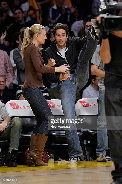 Zachary Levi and Caitlin Crosby attend the Los Angeles Lakers v Atlanta Hawks NBA basketball game at Staples Center on November 1 2009 in Los Angeles...