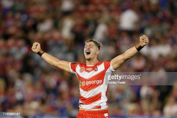 Zachary Lomax of the St George Illawarra Dragons celebrates the win during the round four NRL match between the Newcastle Knights and the St George...